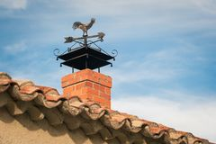 Rooster Themed Weather Vane Silhouetted. Antique Rooster Themed Weather Vane Silhouetted stock photos