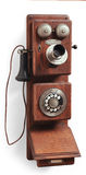 Antique rotary dial telephone on white. Old wood country telephone on white Royalty Free Stock Images