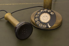 Antique rotary phone. Antique phone with control dial, old rotary telephone Royalty Free Stock Photo