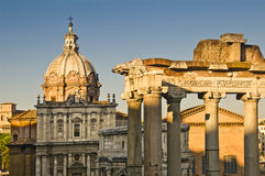 Antique ruins and baroque church in Rome, Italy. Typical baroque church and part of the antique forum in Rome, Italy Royalty Free Stock Photography