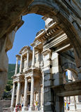 Antique ruins in Ephesus. View of the Celsus Library through the Gate of Maszeus and Mythridates in Efesus, Turkey Royalty Free Stock Photo