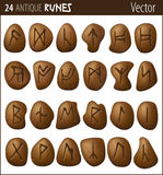 24 Antique Runes. Carved on pebbles Stock Photography