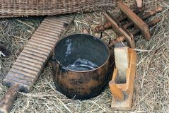 Antique Russian household items on a straw background royalty free stock photography