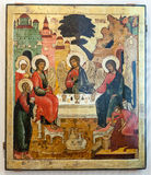 Antique Russian orthodox icon The Old Testament Trinity. VELIKY  NOVGOROD, RUSSIA - JULY 24, 2014: Antique Russian orthodox icon The Old Testament Trinity Royalty Free Stock Photo