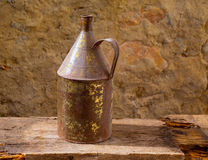 Antique rusted iron jar with aged brass on vintage wood Stock Photography