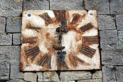 Antique rusted metal wall clock Royalty Free Stock Image