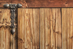 Antique Rustic Pine Wood Barn Door - Detail. Photograph of old, weathered, rustic, knotted Pine wooden door, with wrought iron hinges - detail Royalty Free Stock Photos