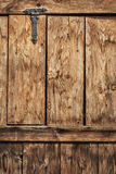 Antique Rustic Pine Wood Door With Wrought Iron Hinge - Detail. Photograph of old, weathered rustic Pine wooden door, with wrought iron hinges - detail Stock Photo
