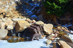 Antique Rusting Universal Rock Ore Crusher. Decaying in a River Stock Image