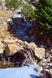 Antique Rusting Universal Rock Ore Crusher. Decaying in a River Stock Photo