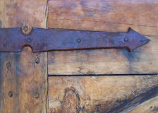 Antique Rusty Arrow Hinge and Door Stock Photography