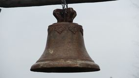 Antique rusty bronze bell ringing during church service, history museum exhibit. Stock footage stock footage