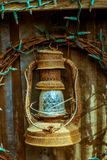 Antique rusty oil/petrol lamp with old christmas lights. very old gas lamp.  stock image