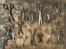 Antique rusty scissors rustic wooden background Vintage accessor Stock Photos