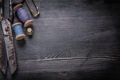 Antique rusty scissors spools of thread thimble Stock Images