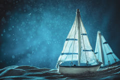 Antique sail boat Toy model. With rope on sand Royalty Free Stock Photography