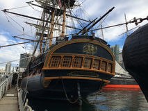 Antique sail ship in the harbor water Royalty Free Stock Photo