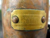 Antique Salt. A close-up of the label of an antique salt shaker Stock Photos