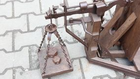 Antique scale. Weights on the scales in balance stock video