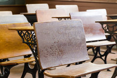 Antique School Desks. Old-style wooden school desks from a historic American midwest rural elementary school Stock Photography