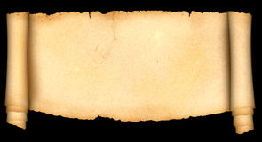 Antique scroll of parchment on black background. Royalty Free Stock Images