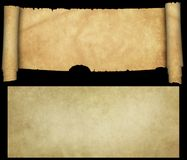 Antique scroll with torn edges and old paper sheet on black back. Antique parchment with two rolls and torn edges. Isolated on black background Stock Photo
