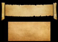 Ancient parchment scroll and old paper texture. Antique scroll with torn edges and old yellowed paper sheet for design. Isolated on black background Stock Images