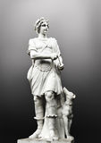 Antique sculpture man with dog. Antique sculpture hunter man with dog Royalty Free Stock Photos