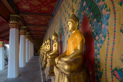 Free Antique Sculpture Of A Seated Buddha In The Gallery Of Wat Arun, Thailand Stock Photography - 75640782