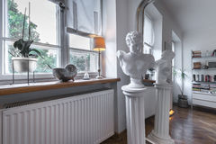 Antique sculpture in post modern interior. Design Stock Photography