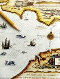 Antique sea navigation map. Exotic tourism and travels faraway theme - An image of a brown pencil pointing to an old antique sea map or nautical chart showing a Royalty Free Stock Images