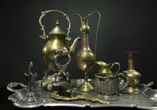 Antique service. Antiques on an old silver tray on a dark backgr stock images
