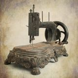 Antique sewing machine. Isolated brown antique sewing machine stock photography
