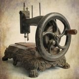 Antique sewing machine. Isolated brown antique sewing machine royalty free stock photography