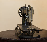 Antique sewing machine. Placed on antique coffee table royalty free stock photos