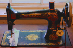 Antique Sewing Machine. A fancy antique singer treadle sewing machine Royalty Free Stock Photos