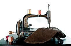 Antique sewing machine, isolated stock photography