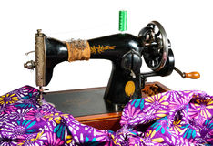 Antique sewing machine. Old sewing machine and colored cloth for making dresses Royalty Free Stock Image