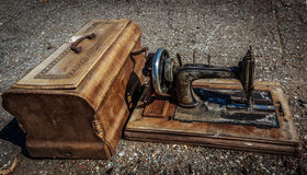 Antique sewing machine. Old rusty vintage sewing machine with wooden case Royalty Free Stock Photos