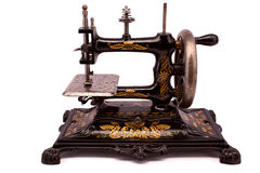 Antique sewing machine on white background Stock Photography