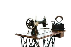 Antique sewing manual machine and old coal iron - vintage tailor stock illustration