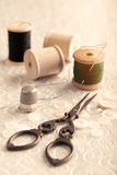 Antique Sewing Scissors. And thimble with needles and cotton Stock Photo