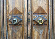 Antique shabby door with knobs. Antique shabby door with round handles and lock Royalty Free Stock Images