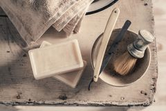Antique shave tools. Sharp razor, soap and brush royalty free stock photo