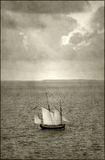 Antique ship near island Royalty Free Stock Images
