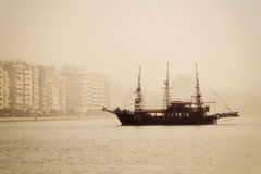 antique ship in the port of Thessaloniki a day with fog Royalty Free Stock Photo