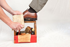 Antique shoe shine box and worker Royalty Free Stock Photography
