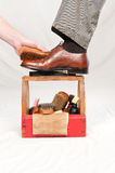 Antique shoe shine box and worker Stock Photography