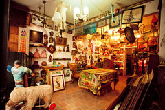 Antique shop with second hand furniture, toys, books and art-objects Stock Photos
