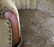 Antique side chair. Beautifully upholstered antique side chair with detailed view of curved arm stock image